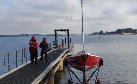 Satyr, a sailing boat, being coaxed down the slipway